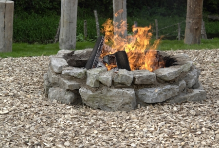 wood burning: outdoor fireplace with burning fire