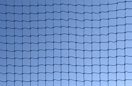 full frame background showing a dark netting in front of blue sky photo
