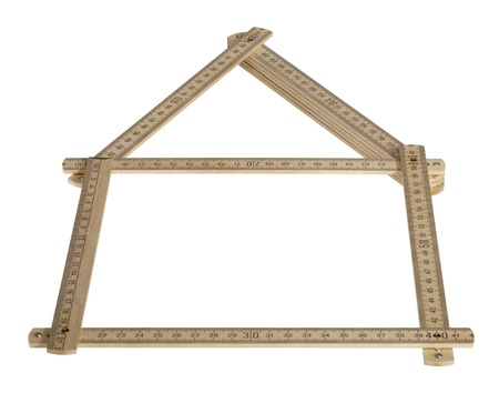 wooden metre: studio photography showing a wooden yard stick shaped like a symbolic house. Isolated on white with clipping path