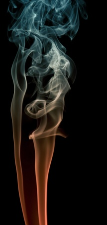 particulates: abstract picture showing some colorful smoke in black back