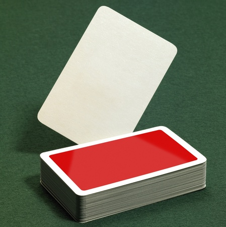 low angle studio photography showing a stack of red playing cards on green felt background Stock Photo - 10984094