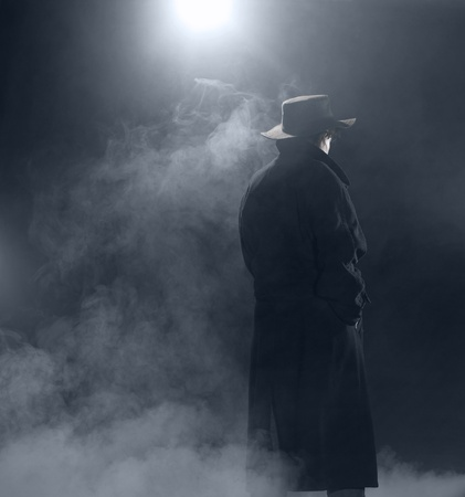woman with dark coat standing in the fog Stock Photo - 10984536