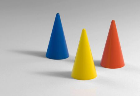 parlour games: studio photography of three colored tapers in light back