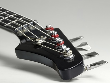 detail of a bass guitar in light grey back photo
