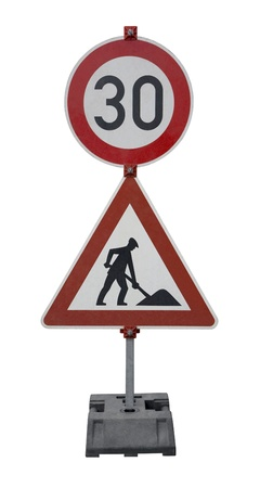symbolization: road works and tempo limit sign on stand isolated on white
