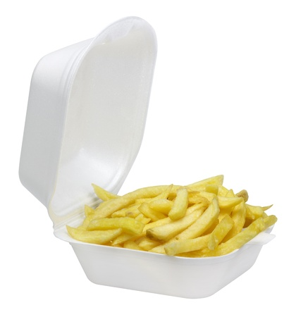 some french fries in a open white plastic box isolated on white photo