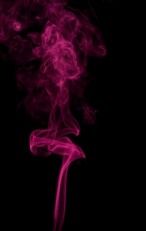particulates: abstract background showing some magenta colored smoke in black back