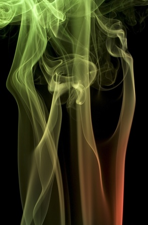 particulates: abstract picture showing some colorful smoke in front of black back Stock Photo