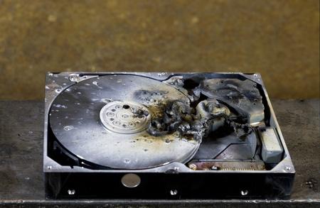 detail shot of a massive destroyed hard disk drive photo