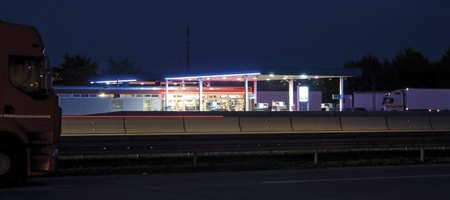 illuminated service station near highway in Germany at late evening time photo