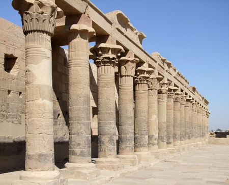 a row of ancient stone columns at the temple of Isis in Egypt photo