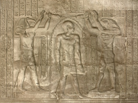 allegory painting: detail of a relief at the ancient Temple of Kom Ombo in Egypt (Africa)
