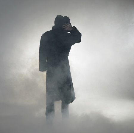 woman with dark coat standing in the fog Stock Photo - 10987389