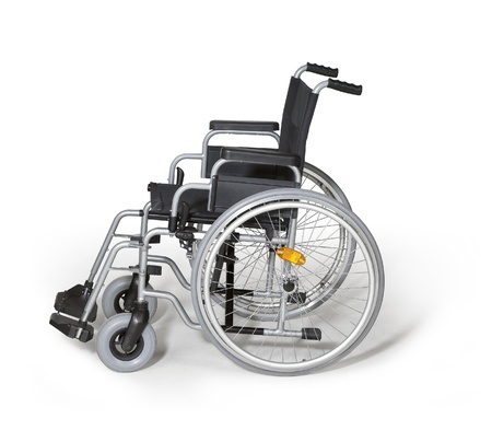 studio photography of a empty wheelchair in white back with shadow photo