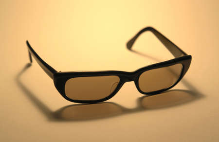 accouterment: studio photography of original sunglasses from the seventies in warm ambiance