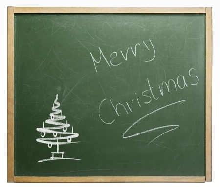 home schooling: old used blackboard with written Merry Christmas on it. Studio photography in white back Stock Photo