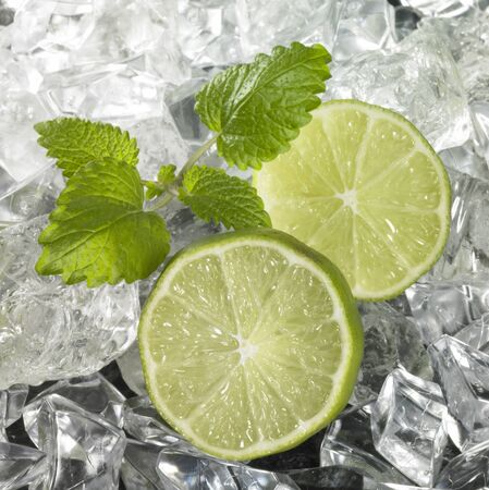 studio photography of some sliced lemon fruits and lots of ice cubes Stock Photo - 10987962