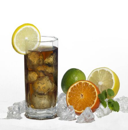 moistness: studio photography of a iced soft drink in light back, with citrus fruits and crushed ice