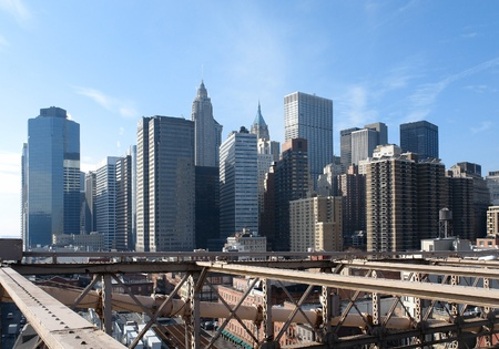 urbanized: sunny city view of New York seen from Brooklyn Bridge (USA)