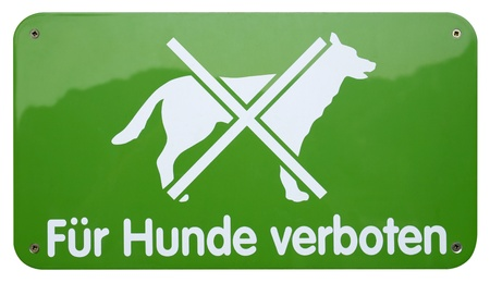 symbolization: Studio photography of a german No dogs prohibition sign isolated on white with clipping path