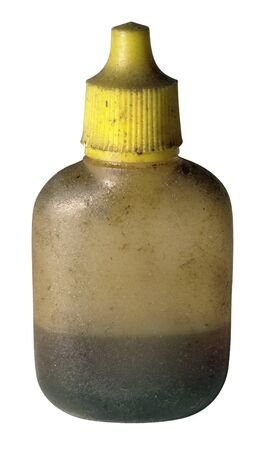 oil bottle: studio photography of a dirty old oil bottle made of translucent plastic, isolated on white with clipping path