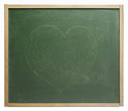 unobtrusive: old used blackboard with unobtrusive painted heart shape on it. Studio photography in white back