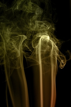 wavily: abstract picture showing some multicolored smoke in dark background