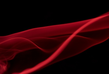 zero gravity: abstract background showing some red smoke in black back