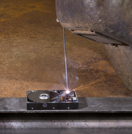 welding scenery with hard disk drive, welding mask detail and flying sparks