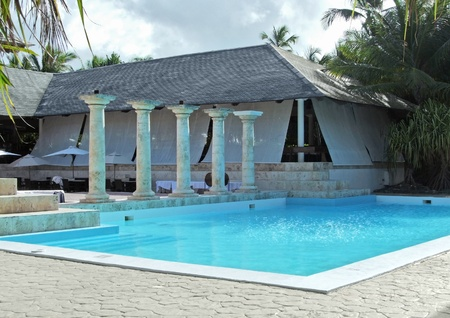 commercialization: holiday resort with pool at the Dominican Republic, a island of Hispanola wich is a part of the Greater Antilles archipelago in the Carribean region