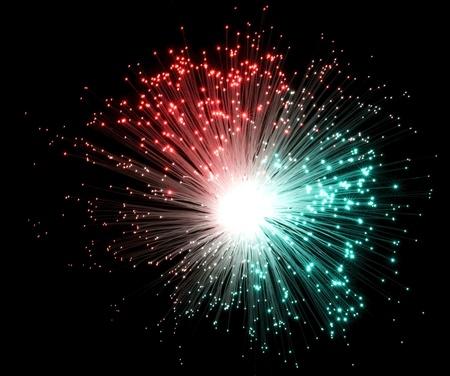 colorful illuminated plastic optical fibers in dark back Stock Photo - 11013792