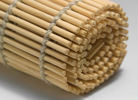 detail of a rolled wooden mat in light back photo