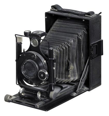 folding camera: nostalgic folding camera in white back Editorial
