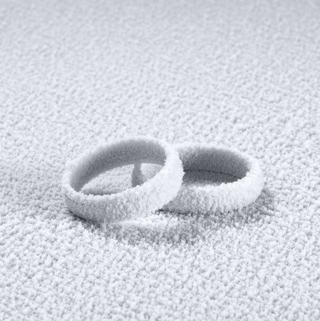 accouterment: studio photography of two frosted wedding rings in cold ambiance