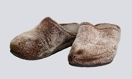 a pair of brown fluffy slippers in light grey back photo