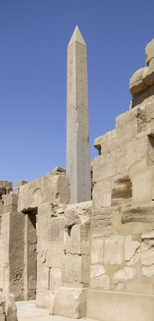 obelisk stone: scenery around Precinct of Amun-Re in Egypt showing a obelisk and stone ruins Stock Photo