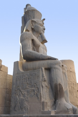 sideways shot of a sitting pharaonic statue at the ancient Luxor Temple in Egypt (Africa) photo