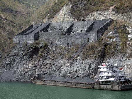 yangtze river: chinese cargo ship and gravel distribution at yangtze river