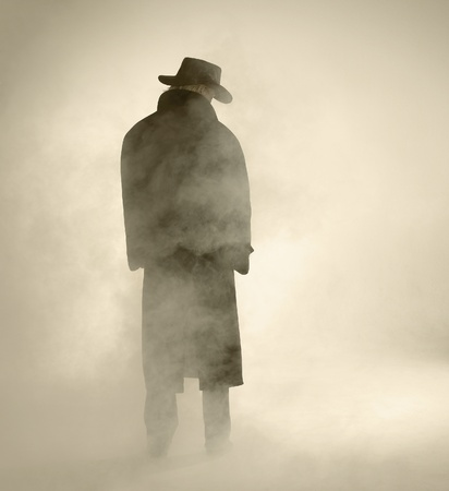 woman with dark coat standing in the fog Stock Photo - 11718204