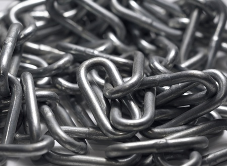 restraining device: full frame abstract detail of a steel chain