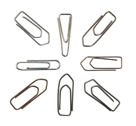 justified: studio photography of various paper clips in white back