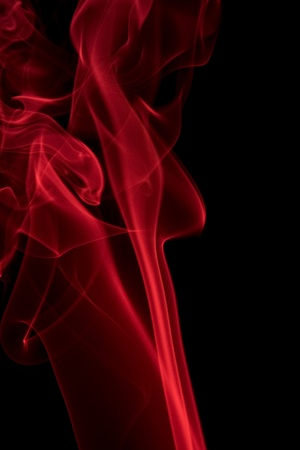 particulates: abstract background showing some red smoke in black back