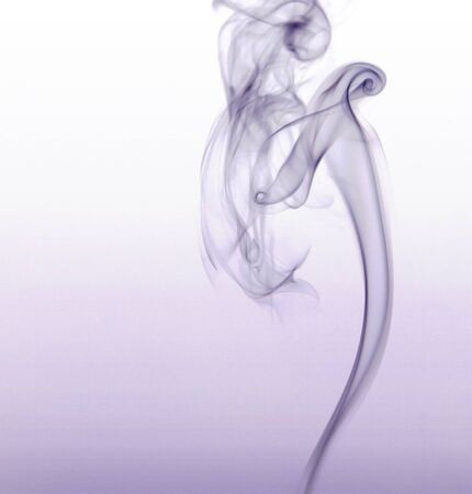 particulates: abstract picture showing some violet smoke in light gradient back Stock Photo