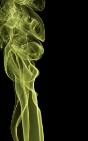 wavily: abstract background showing some green smoke in dark back Stock Photo