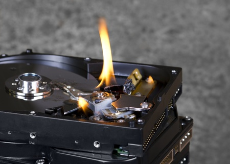 fixed disk: detail shot showing some burning hard disk drives Stock Photo