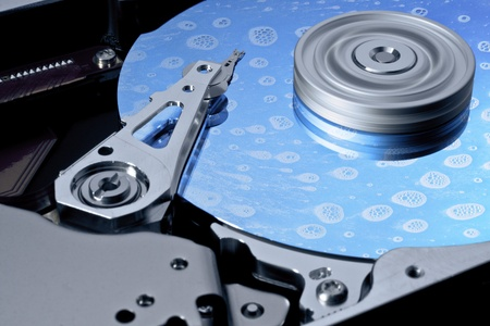 symbolic computing theme showing a open hard disk while cleaning photo