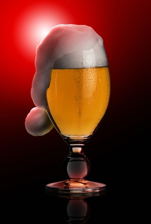 studio photography showing a glass of pils beer with funny foam shaped like a jelly bag cap in black back photo