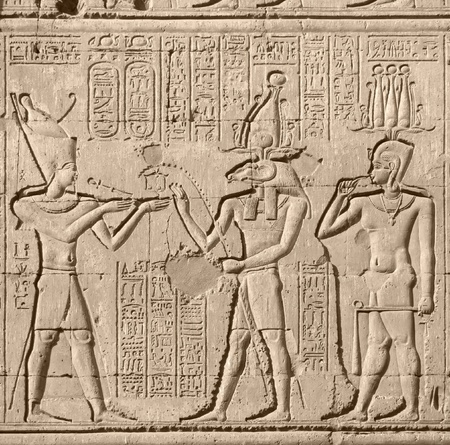 stone relief at Chnum temple in Egypt photo