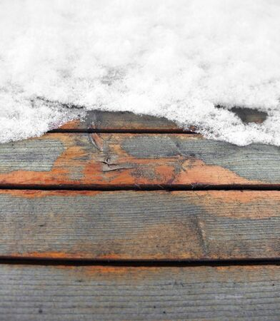 rundown: partly snow-covered rundown wooden boards Stock Photo