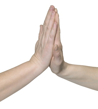 allegory painting: studio photography of two hands giving high five in white back Stock Photo